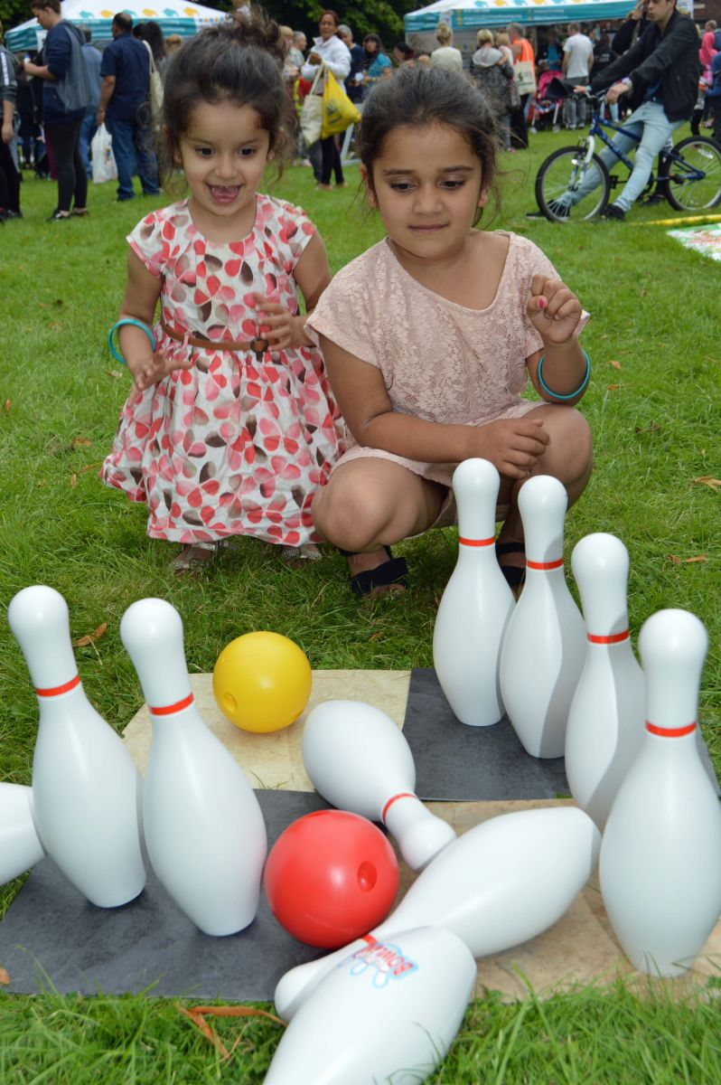Young people are bowled over at Six Town Housing's Summer Roadshow in Bury