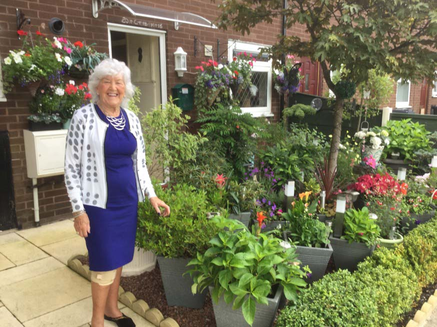 Jean from Five Quarters in Radcliffe won Best Pots, Baskets and Small Spaces in the Six Town Housing gardening competition