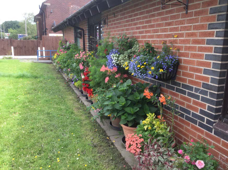Moorfield Sheltered Scheme, Radcliffe, won the runner-up prize in the Six Town Housing gardening competition for Best Communal Garden