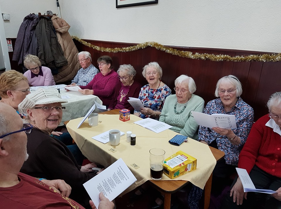 Residents at the Christmas sing-a-long run by Seedfield TRA