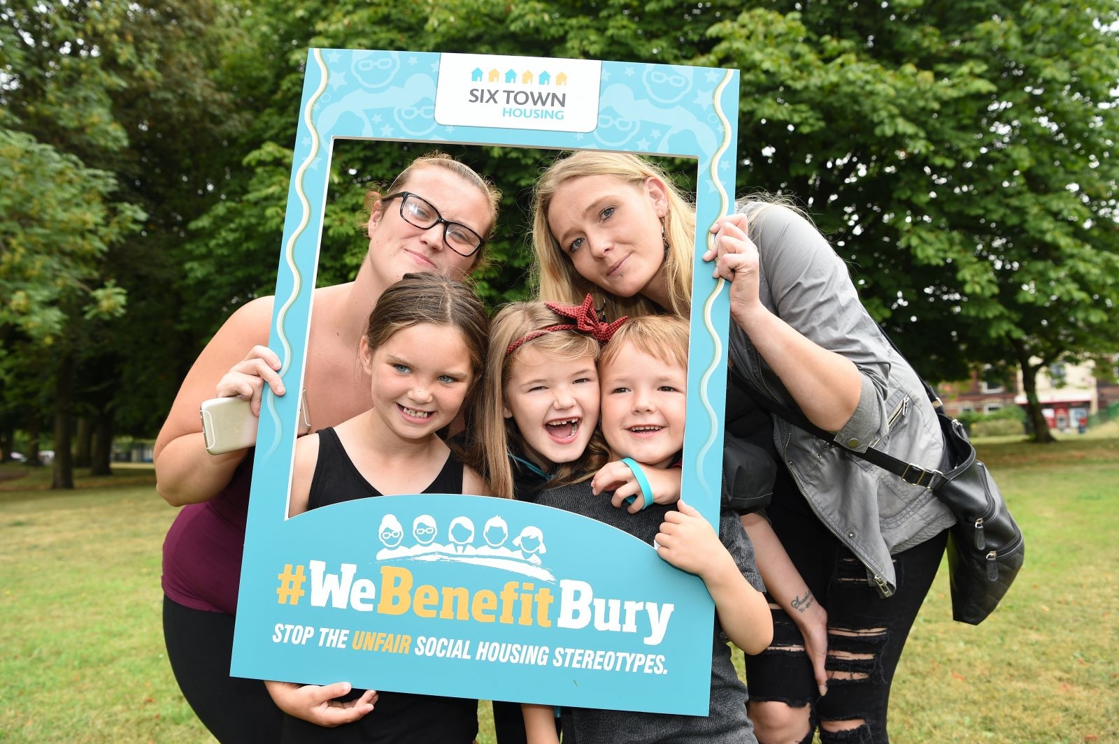 Tenants pose for a #WeBenefitBury selfie at Six Town Housing's Summer Roadshow; Amy Leighton with Kayla Alder (7), Lexie (7), Luca (5) and Melissa Peters