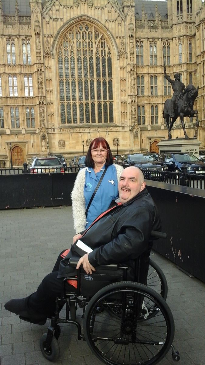 Bryan with Stephanie Jackson (Sevacare Team Leader who supported Bryan on his trip) outside Parliament