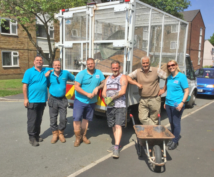 Six Town Housing staff and a cage van used for clearing rubbish