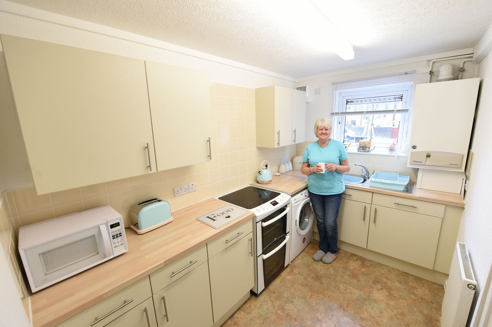 A tenant  in a brand new kitchen installed as part of Six Town Housing's capital works programme