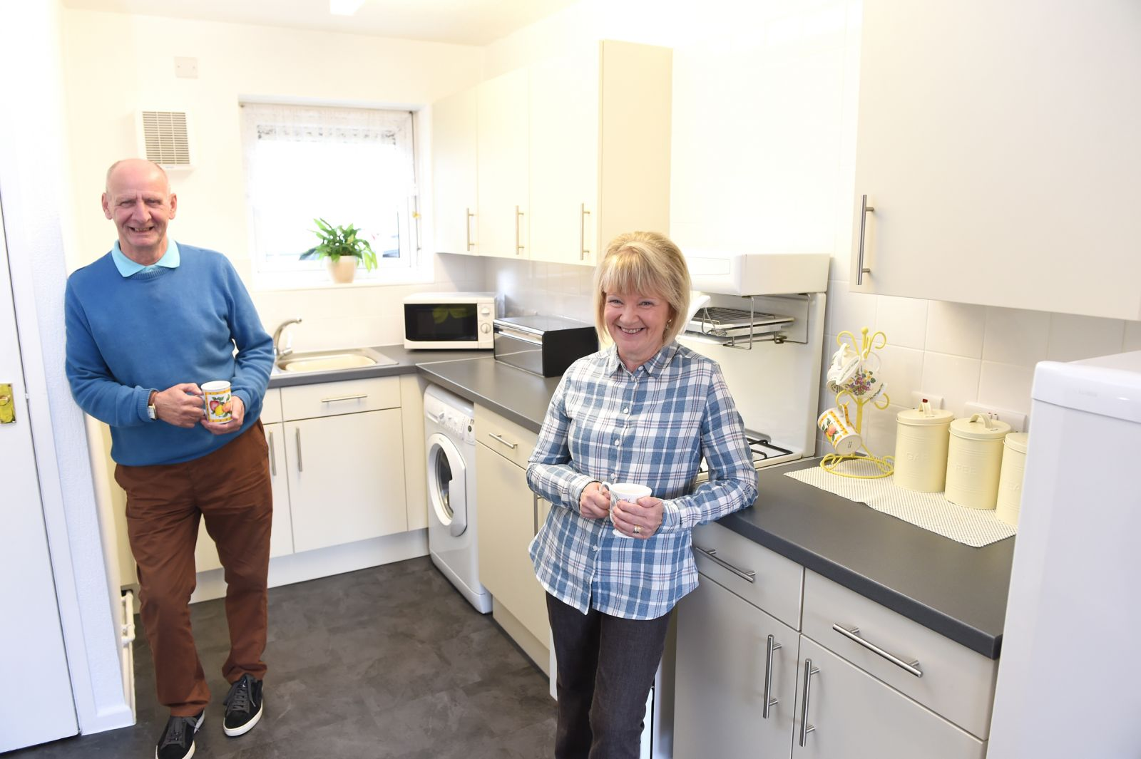 Six Town Housing tenants in a newly installed kitchen.