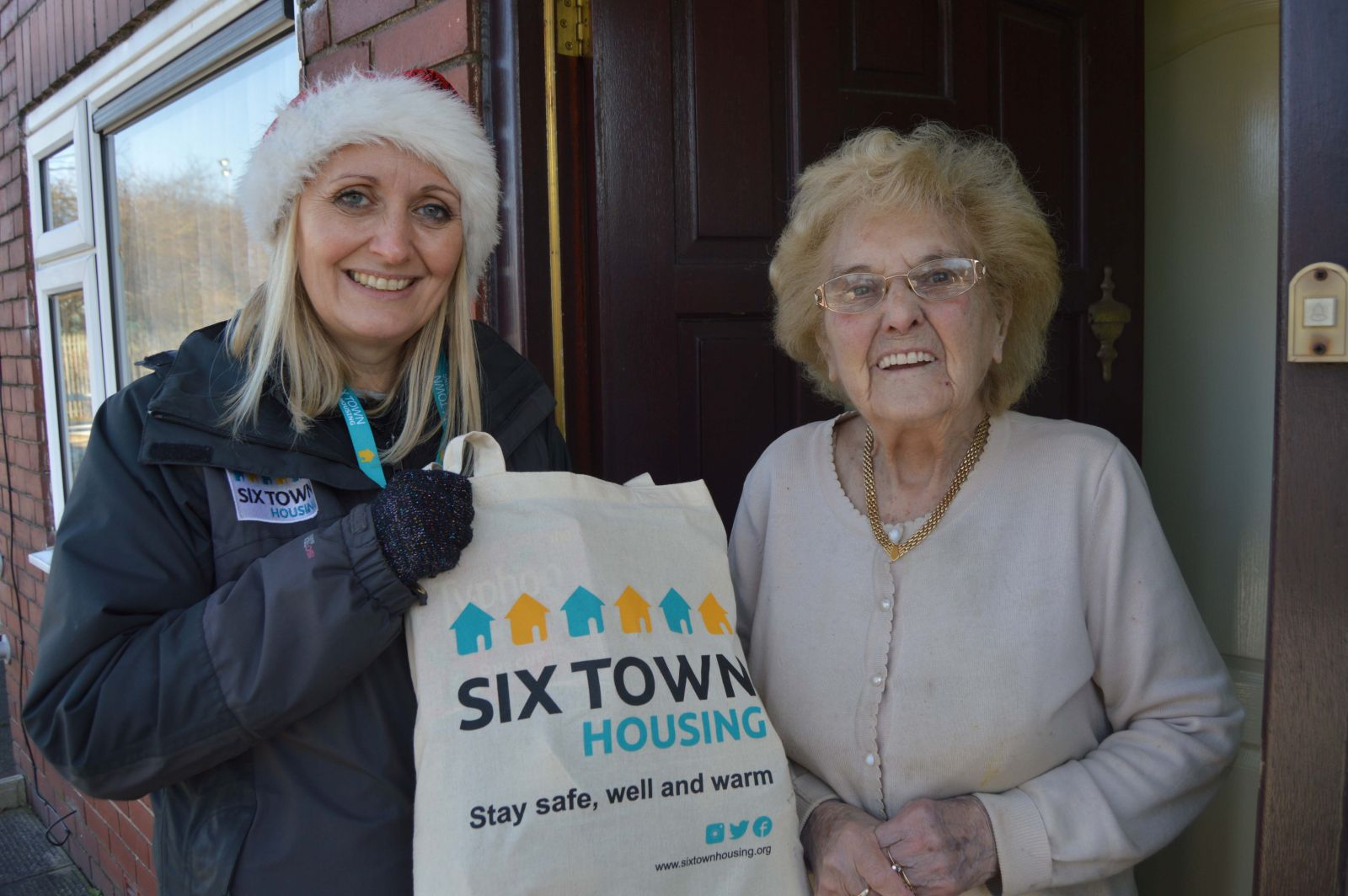 A tenant in Radcliffe receives a Winter Warmers pack