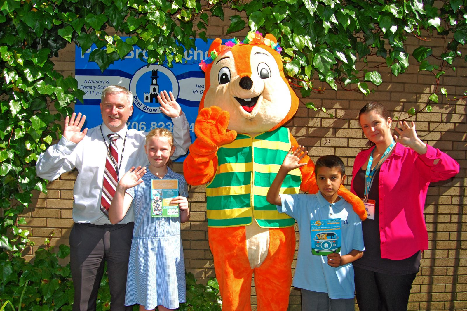 Cyril at Peel Brow Primary School with Headteacher Danny Mellor, Emily Cunliffe (Year 5 Age 10), Tahir Mahmood (Year 4, Age 9) and Six Town Housing Community Development Worker Ashleigh Hogan on July 4th 2016.