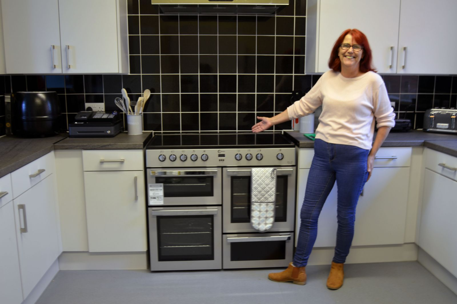 Kath shows off some of the new kitchen at Chesham Fold TRA.