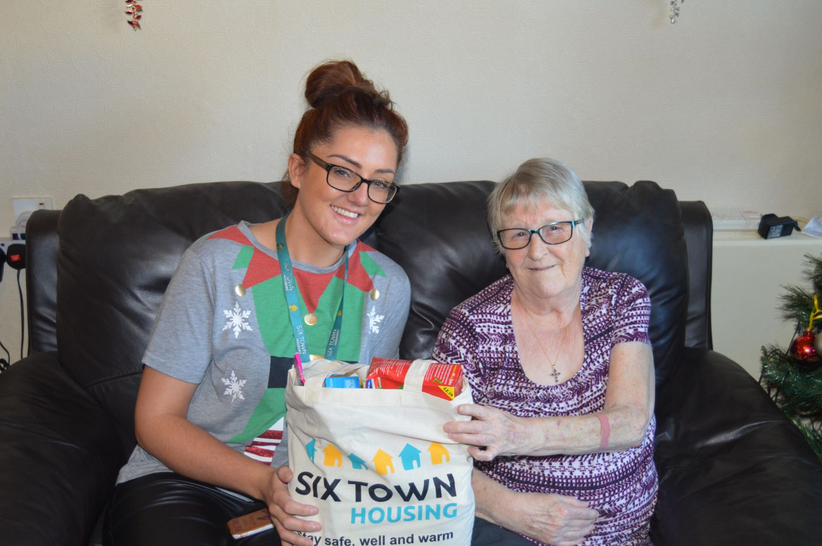 A Six Town Housing tenant receives a Winter Warmer pack