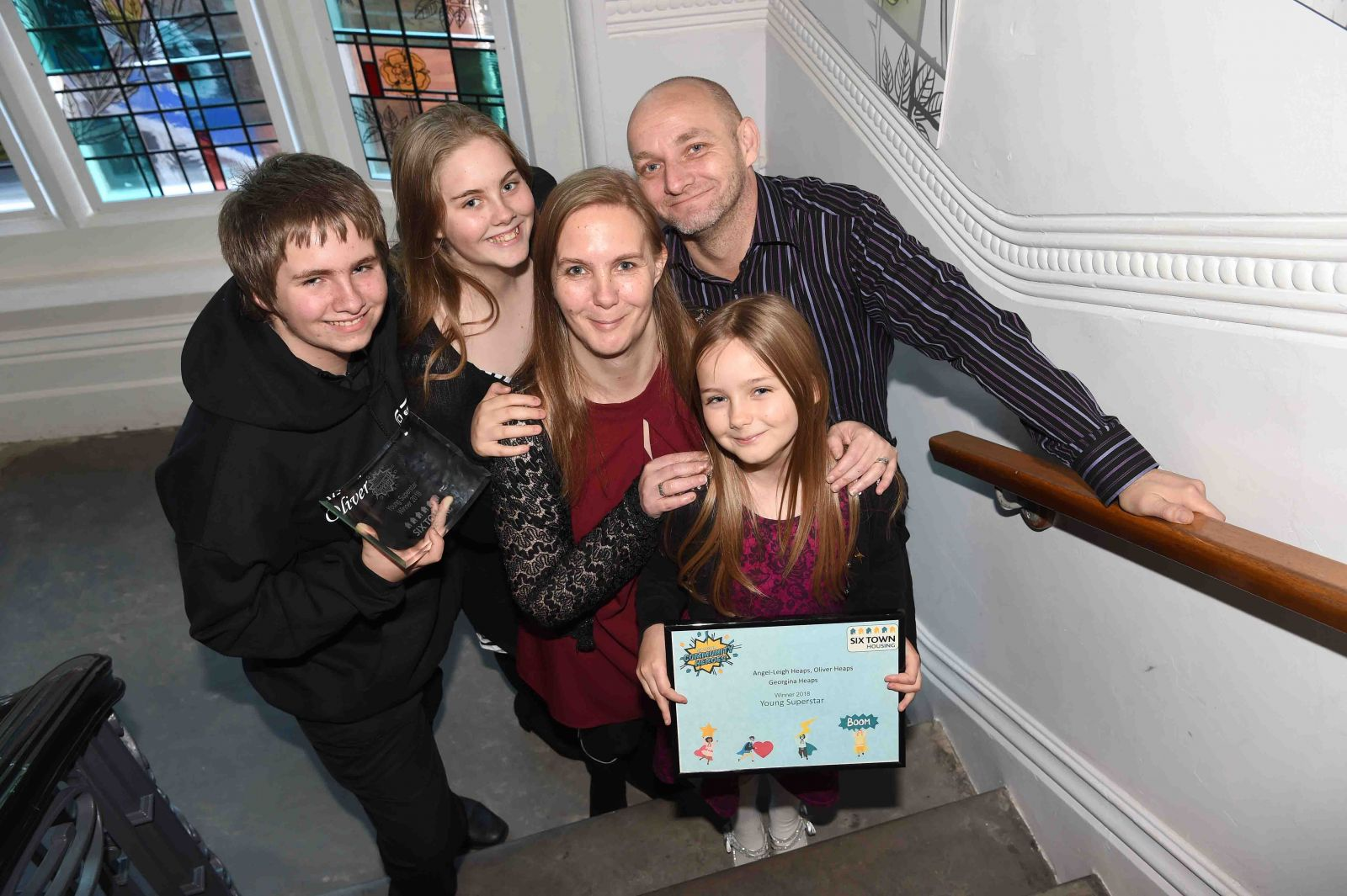 Young winners of the Community Heroes Awards with their parents