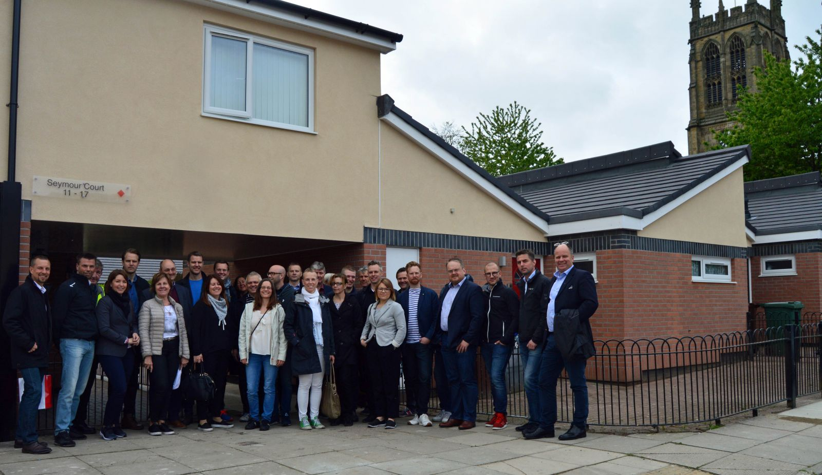 Swedish delegation visit St Thomas Estate in Radcliffe following new rendering work arranged by Six Town Housing