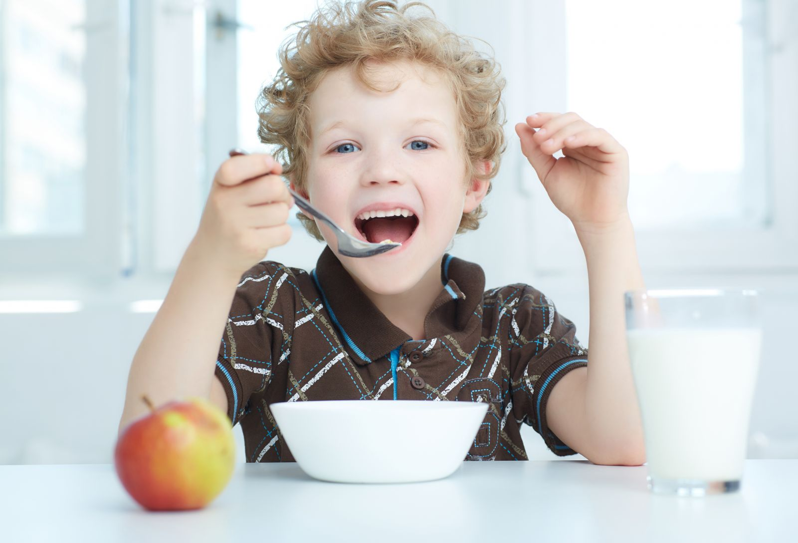 A young boy enjoying breakfast